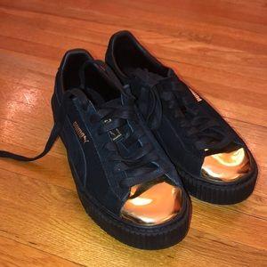 Puma Platform Black and Gold tip sneakers